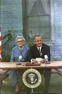 1965 - President Lyndon Johnson signs the Elementary and Secondary Education Act as a part of his War on Poverty.