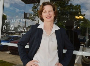 Michelle Nunn (D), standing in front of the Points of Light Foundation offices in Atlanta on Marietta Street.